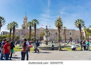 Arequipa, Peru - August 15, 2015: People and tourists roaming in Plaza de Armas and in front of the Cathedral in Arequipa, famous travel destination and landmark in Peru.