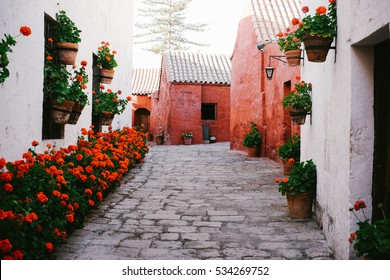AREQUIPA, PERU - CIRCA OCTOBER 2016: An alley inside Santa Catalina monastery, a unique convent for nuns built from the 16th-century in Arequipa, Peru