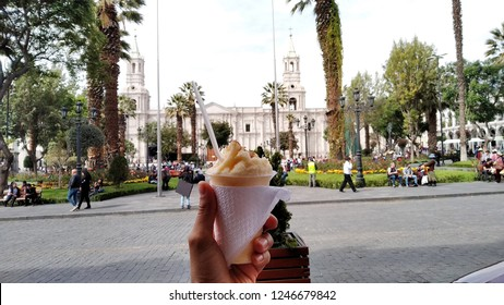 Arequipa / Peru - December 1 2018: Cheese Ice Cream (Queso Helado) with the basilica cathedral in the background