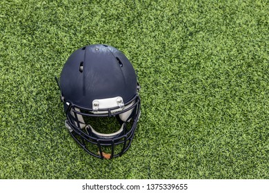 Arerial view of a single football helmet laying on the grass