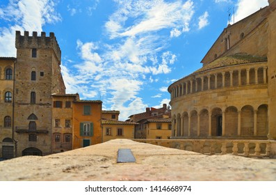 AREZZO,  Cityscape with Piazza Grande square in Arezzo with facade of old historical buildings against cloudy blue sky , Tuscany, Italy