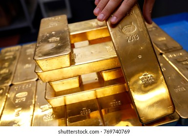 AREZZO, ITALY- 19 JULY 2013: Gold bars are seen at a precious metals refinery plant.