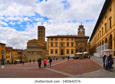 AREZZO, ITALY 25.04.2019. Cityscape with Piazza Grande square in Arezzo with facade of old historical buildings and crowd of people against cloudy blue sky , Tuscany, Italy