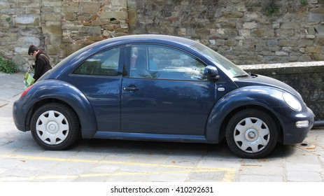 AREZZO, ITALY - CIRCA APRIL 2016: blue Volkswagen New Beetle car parked in a street of the city centre