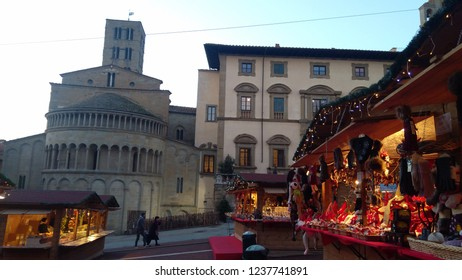 AREZZO - ITALY - DEC 1, 2017: Popular fair with sale of Christmas objects in Piazza Grande, famous square in the Italian city of Arezzo