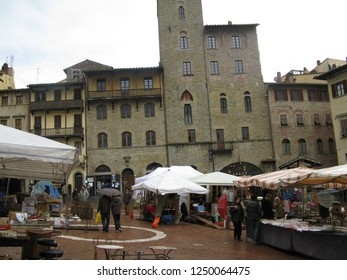 Arezzo, Italy - February, 02, 2008: Tourists and locals at the monthly antique fair held in the main square