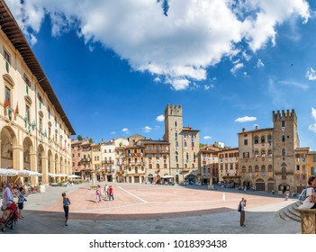 AREZZO, ITALY - JUNE 2015: Piazza Grande with tourists. Arezzo is a famous destination in Tuscany.