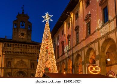 AREZZO, ITALY - NOVEMBER 22, 2018: Christmas in Arezzo, Tuscany. Christmas tree and market in 'Piazza Grande', city main square