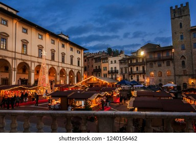AREZZO, ITALY - NOVEMBER 22, 2018: Christmas in Arezzo, Tuscany. People visit Christmas Market in 'Piazza Grande', city main square