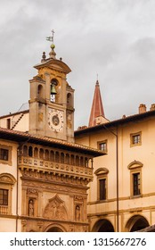 AREZZO, ITALY - NOVEMBER 23, 2018: Palace of the Fraternity of the Laity in Arezzo Piazza Grande with old 16th century clock