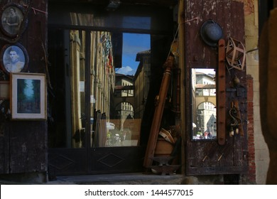 Arezzo, Italy - OCTOBER 19, 2015: Whimsical kaleidoscope of reflections of the main square and the cathedral in the mirrors and glass windows of an antique shop in Arezzo