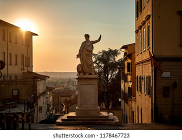 Arezzo, Italy September 12 2018: Marble statue in the square in Arezzo, Italy with the sunset light