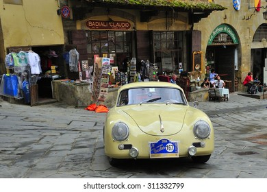 AREZZO, ITALY - SEPTEMBER 20: A yellow Porsche 356 A takes part to the GP Nuvolari classic car race on September 20, 2014 in Arezzo. The car was built in 1957