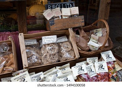 AREZZO, TUSCANY, ITALY - JANUARY 10, 2016: Typical Italian products displayed on the storefront of Antica Bottega Toscana, one of the oldest shops in Arezzo selling typical food products of Tuscany.