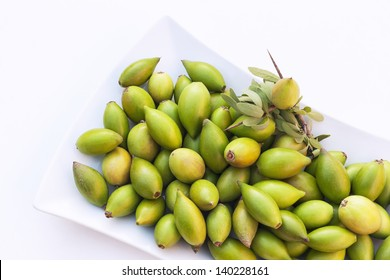 Argan nuts from the Argan tree, that is cultivated for the oil (argan oil) which is found in the fruit. The oil is rich in fatty acids and is used in cooking and cosmetics.