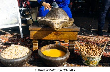 ARGAN OIL. Making of argan oil from argan nuts and seeds in Morocco. Traditional method