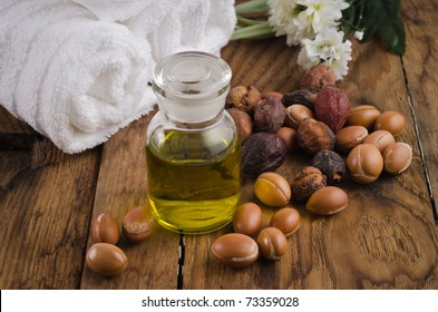 Argan oil for massage and argan fruit. Spa mood