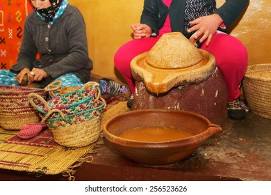 argan oil processing by hand by women used in cosmetics and food morocco