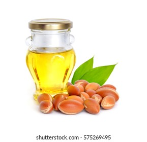 Argan seed with oil. Isolated.
