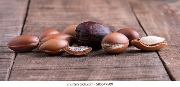 Argan seeds on wood.