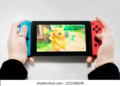 Argentina 22 of august 2018. young woman playing in nintendo switch, let's go pikachu!, pokémon.