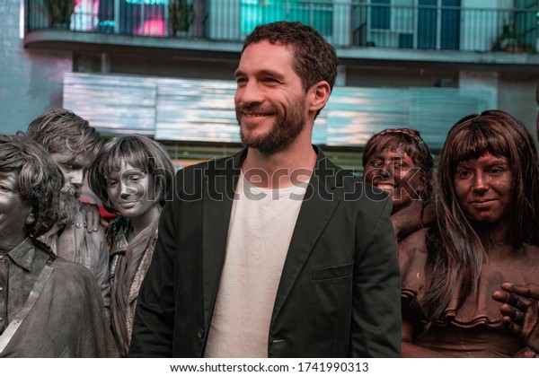 Argentina, Buenos Aires City - October 29, 2018: Argentine actor Michel Noher poses for photos on the street before entering an event
