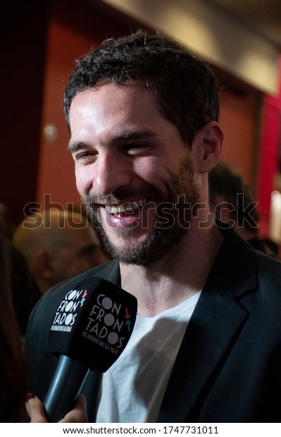 Argentina, Buenos Aires City - October 29, 2018: Argentine actor Michel Noher answers an interview on the street before entering an event.