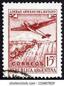 ARGENTINA - CIRCA 1946: a stamp printed in the Argentina shows Plane over Iguassu Falls, circa 1946
