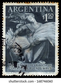 ARGENTINA - CIRCA 1954: A stamp printed in Argentina shows young woman holding a sheaf of wheat, circa 1954