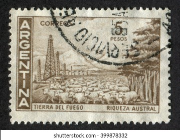 Argentina - CIRCA 1959: Postage stamp printed in Argentina shows herd of sheep. 5 pesos. Tierro del Fuego, Riqueza Austral circa 1959
