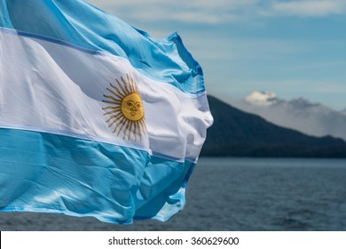 Argentina flag with mountains in background