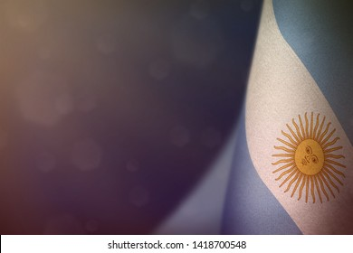 Argentina hanging flag for honour of veterans day or memorial day on blue dark velvet background. Argentina glory to the heroes of war concept.