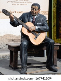 Cosquín, Argentina; June 18, 2018; Sculpture of the Argentine popular singer and guitarrist Atahualpa Yupanqui, exhibited in the center of the city. Made by the artist Fernando Pugliese.