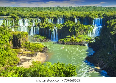 Argentina - Misiones - Iguazu falls - Impressive panorama view of Argentine side of Iguazu waterfall flows and streams falling down to Parana river surrounded by tropical jungle forest
