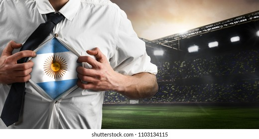 Argentina soccer or football supporter showing flag under his business shirt on stadium.