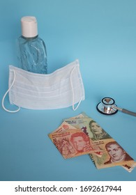 argentine banknotes, mask, bottle with gel alcohol and stethoscope on blue background