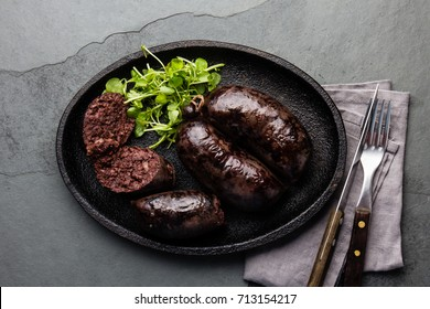 Argentine blood sausages morsilla serven on cast iron platet with sauce