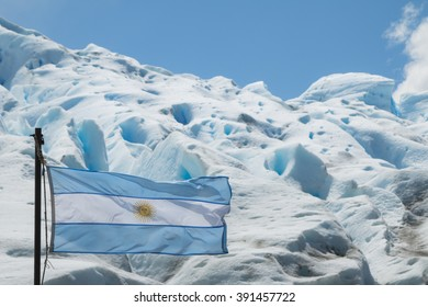 Argentine flag flying in front of the Perito Moreno Glacier in Argentina