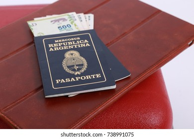 argentine passport and suitcase