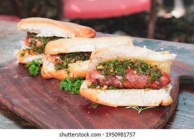 Argentinian choripanes. bbq hot dog witch chimichurri and bacon