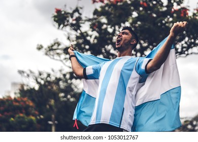 Argentinian fan celebrating during a soccer game
