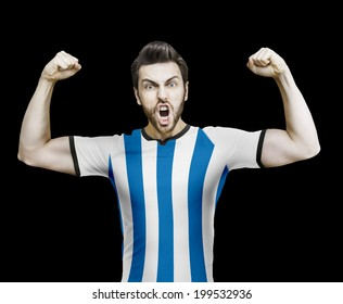 Argentinian soccer player celebrates on the black background
