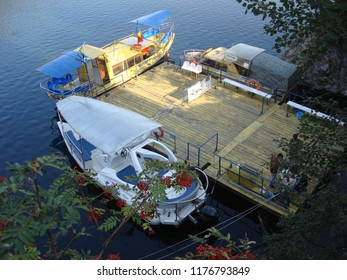 Arges, Romania - 2018 Travel photo from Arges County, Romania. Boats prepared for trip on Vidraru Lake.
