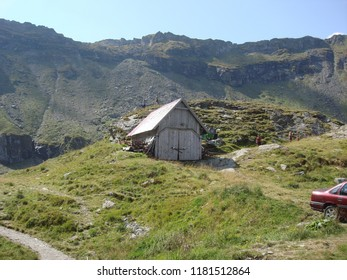 Arges, Romania - 2018 Travel photo from Arges County, Romania. Transfagarasan road crossing the mountains - tourist attraction.  Old wooden shed in mountains.