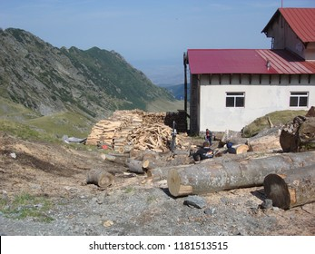 Arges, Romania - 2018 Travel photo from Arges County, Romania. Transfagarasan road crossing the mountains - tourist attraction.  House in mountains, woods for cutting.