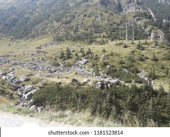 Arges, Romania - 2018 Travel photo from Arges County, Romania. Transfagarasan road crossing the mountains - tourist attraction. Rocks and vegetation.