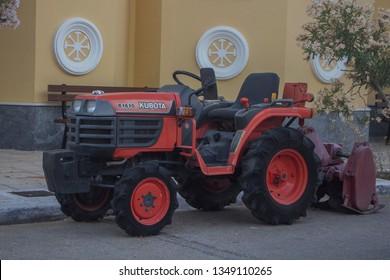 Argostoli, Greece - June, 18: Red Kubota Mini Tractor b1610 in a Greek town Argostoli, on Kefalonia island (Ionian island) in Greece. Capital. Touristic place. June, 18 2016