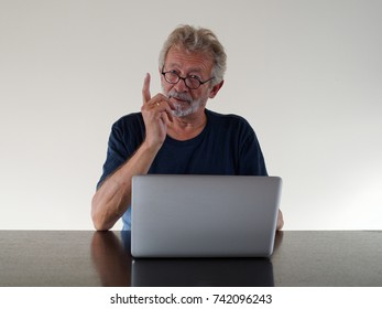 Arguing man with a beard at his laptop