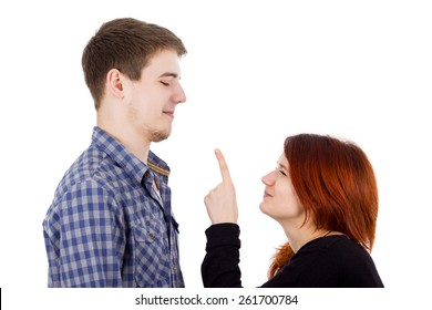 Arguing Young women pointing to a young men isolated over white background.