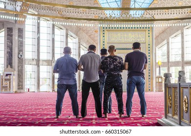 ARGUN, CHECHNYA, RUSSIA - Aug 17, 2016: Muslims praying in Aymani Kadyrova Mosque in Argun, Chechnya, Russia